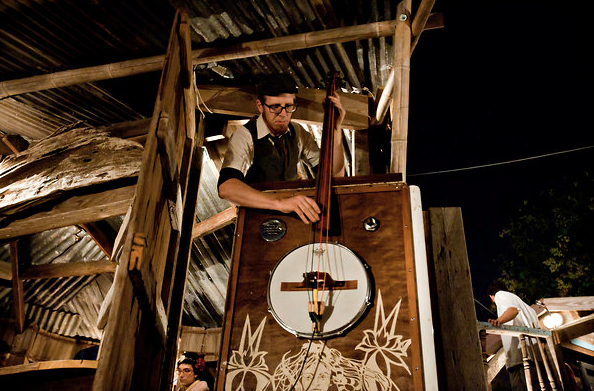 "A musician ""plays"" a house/instrument at Swoon Musical Architecture."