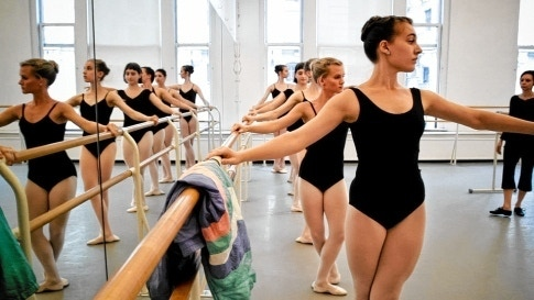 "Anne Marsen (third from left in the mirror) attends ballet class in the dance-film ""Girl Walk."""