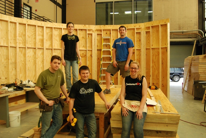 (clockwise) Marina, Will, Stevie, Matt and William after assembly of wall segments in shop.