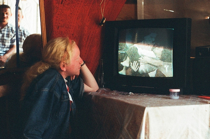 Because Ana Belkis is loosing her vision, she has to sit extremely close to the TV to make out the pictures.