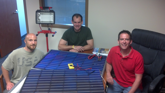 Daren, Tom, and Brian tinkering with the prototype.