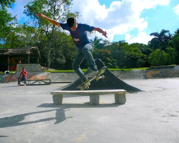 Cuban Skater Roberto Gomez at El Patindromo, backside tail grind on a makeshift fun box.