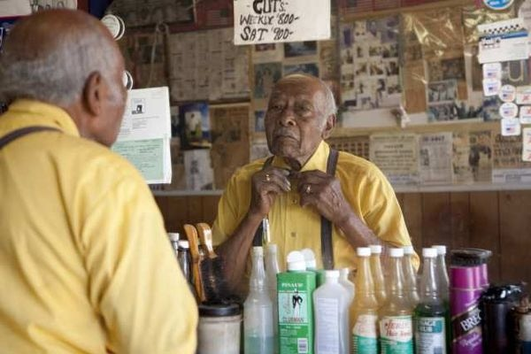 James Armstrong in his barber shop