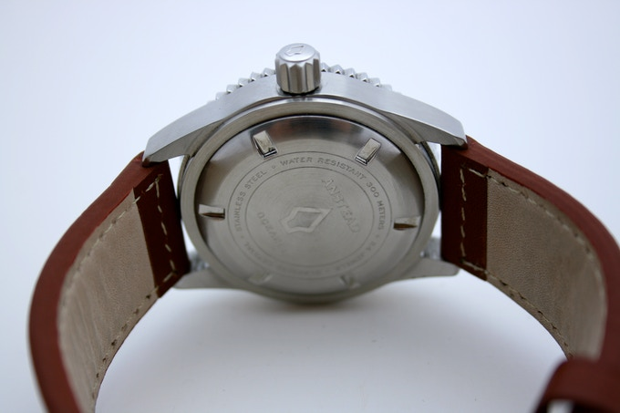 Screw down, engraved caseback (all watches serial numbered)
