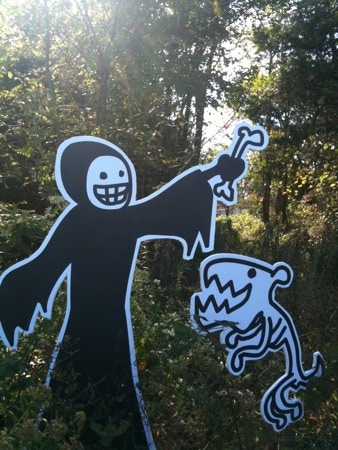 Death and his canine pal Rip at play in the woods.