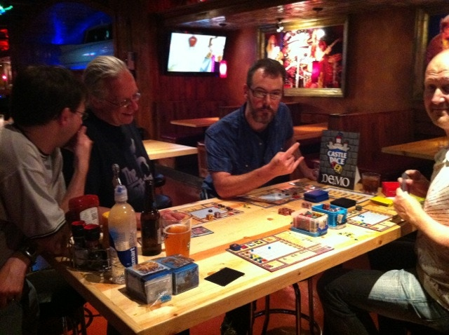 Playing Castle Dice at GenCon with game designer Tim Beach and other attendees of the Diana Jones awards.