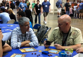 Showing our Euro-style Castle Dice game to a table of actual Europeans at GenCon