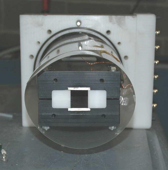 Figure 2: End view of Mark 1 plasma accelerator showing metallic rails (top and bottom) and plastic insulators (left and right)