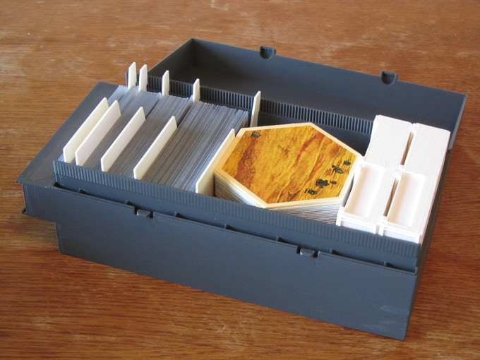 "Magic Chamber (3D Printer) with Bit Pits & Dividers. The prototype is 4"" shorter than the Chamber will be. Shown with Dominion™ Cards and Settler of Catan™ board hexes."