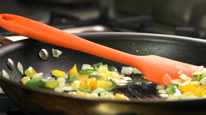 A multi-purpose kitchen tool designed to mix, fold, sauté, and stir foods at any temperature.
