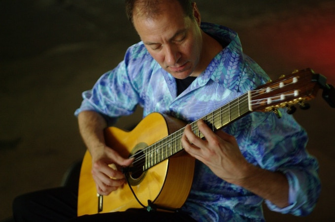 Steve Jarosz, playing spanish music at the April Dinner. PHOTGRAPHED BY KARPOV WRECKED TRAIN