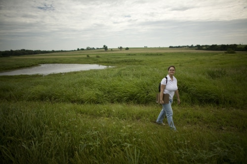 Diana Staresinic-Deane, researcher and author of Shadow on the Hill, walking through the fields of the old Knoblock farm. Photo by Stephan Anderson-Story (who also shot the present-day photos in the video).