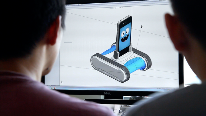 The mechbots designing your new Romo in SolidWorks.