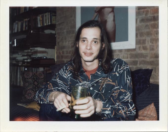 John Waters at Danny Fields NYC pad below Iggy Pop's man-parts '73