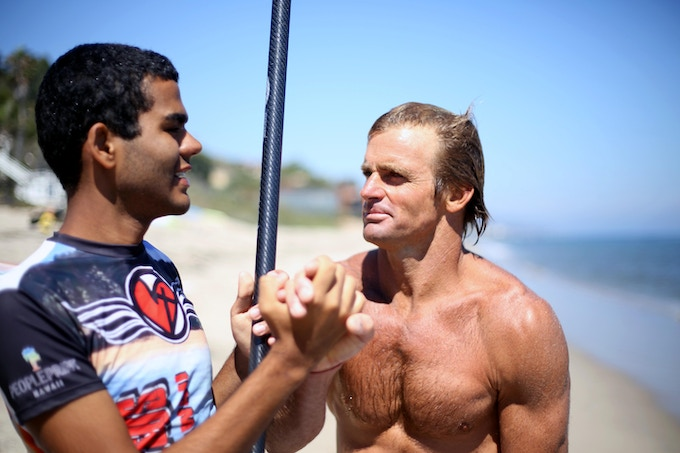 Laird Hamilton and Derek head out for a SUP session in Malibu.