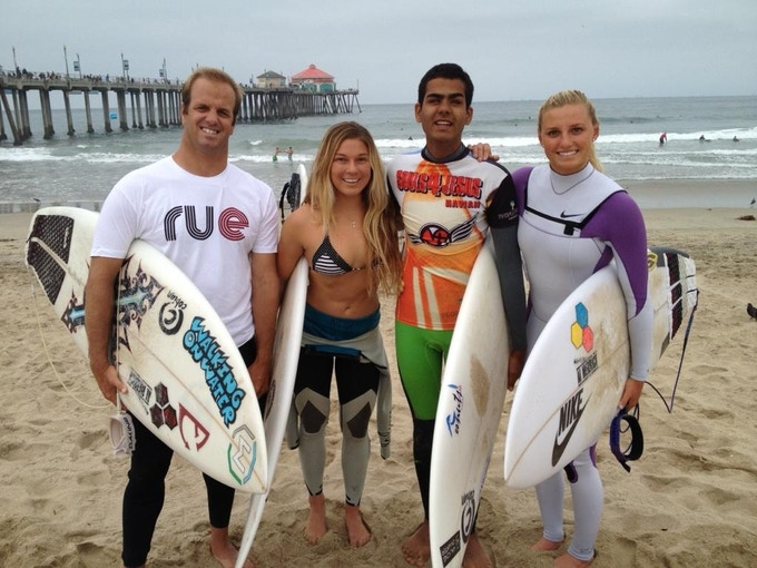 Lakey Peterson and Coco Ho getting ready for a session with Derek and Bryan at Huntington Beach Pier.