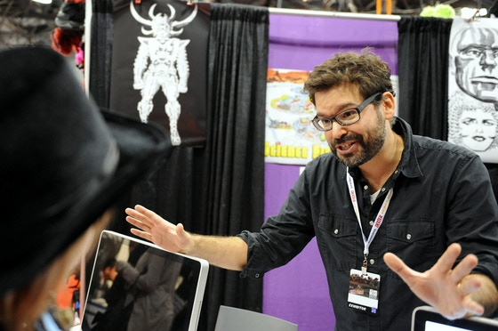 Director Judd Ehrlich talking to a Jack Kirby fan at NY Comic Con. Photo by Kendall Whitehouse.