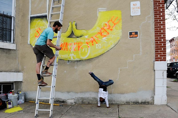 Open Walls Baltimore artist, Overunder, and a local resident of Greenmount West. Photo by Martha Cooper.