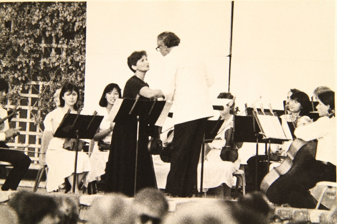 PACO's Founding Conductor, Maestro William Whitson, and violinist Jenny Rudin celebrate a successful performance in this rare, historical photo.