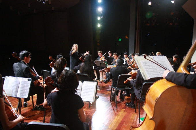 """PACO Guest Conductor Kati Kyme leads the ensemble in a rousing performance of Bela Bartok's """"Divertimento for String Orchestra."""""""