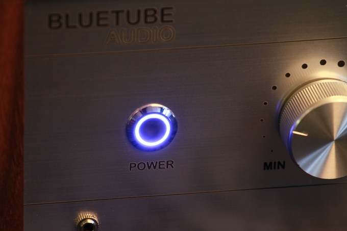 The Power button has a soft blue glow when powered on
