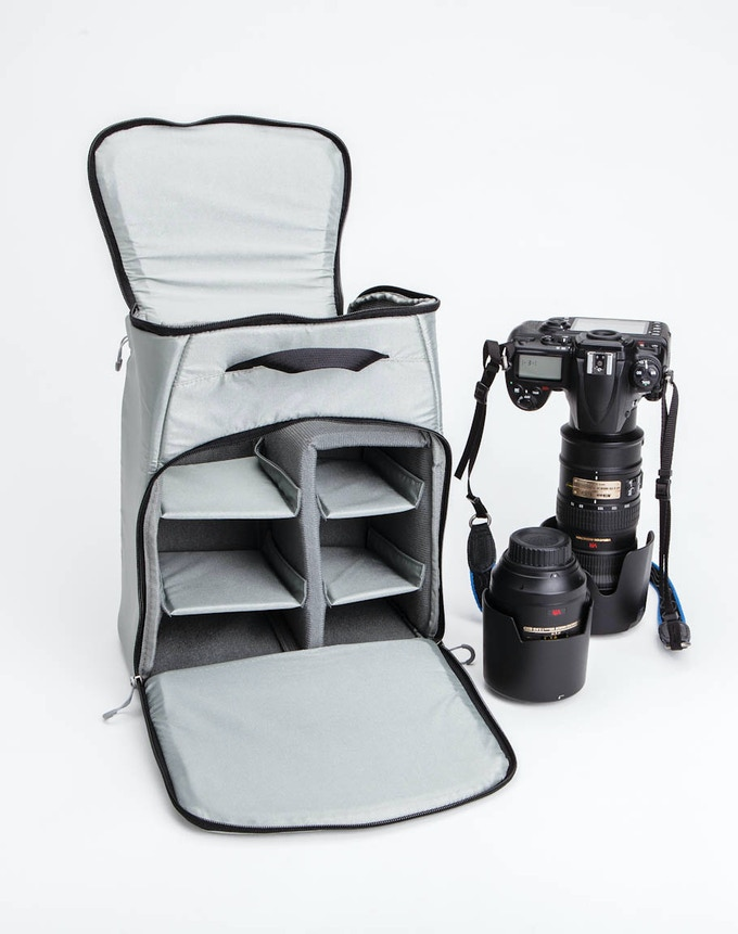 The optional padded camera gear insert (included in both Standard and Deluxe Kickstarter reward packages) holds photo gear up to a 70-200mm lens with body attached and several other lenses.