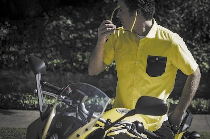 Dylan is wearing a MK II shirt dyed DIY Yellow to match his bike. The shirt has a spread collar and two different pockets, one dyed in a contrasting color.