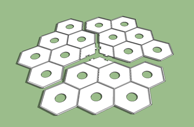 The three interlocking pieces placed near each other to show how it would create the board