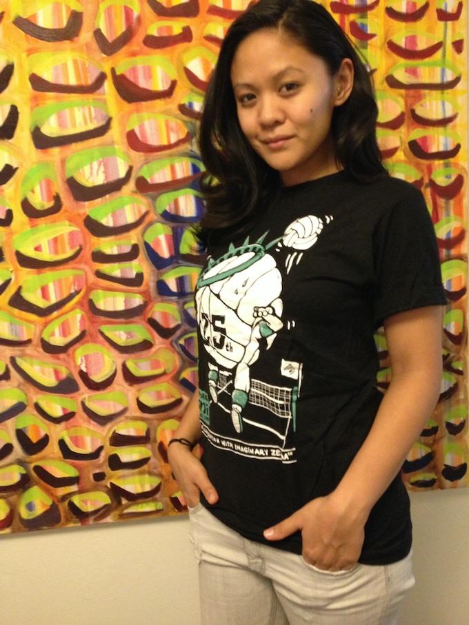 Producer Theresa Navarro models the limited-edition 25th Anniversary NYMini t-shirt.