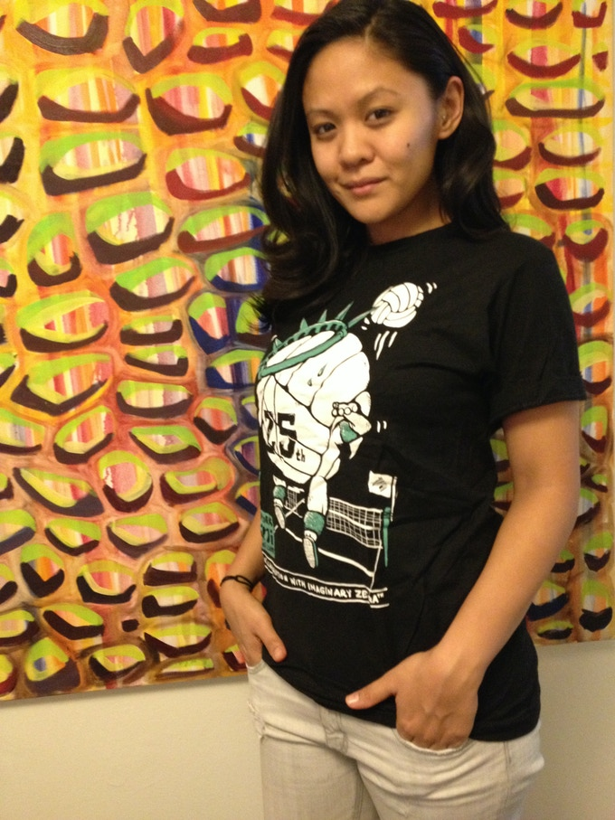 Producer Theresa Navarro models the limited-edition 25th Anniversary NYMini t-shirt.