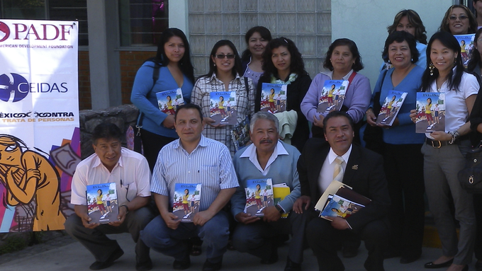 Mexican high school teachers with preview copies of Evelina at a workshop on human trafficking in Mexico City earlier in 2012.