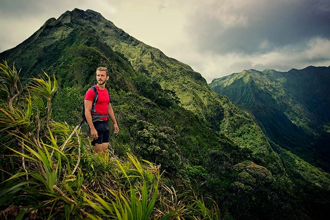 Chase Norton ridge hiking Oahu's Ko'olau Mountains captured by Olivier Renck