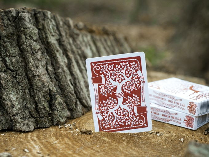 """Mock-up of the back of the cards. Caption on axe handle reads """"Save a tree. Eat a Beaver."""""""