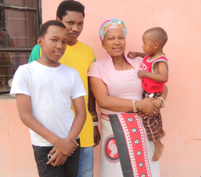 Zanana with her husband and sons