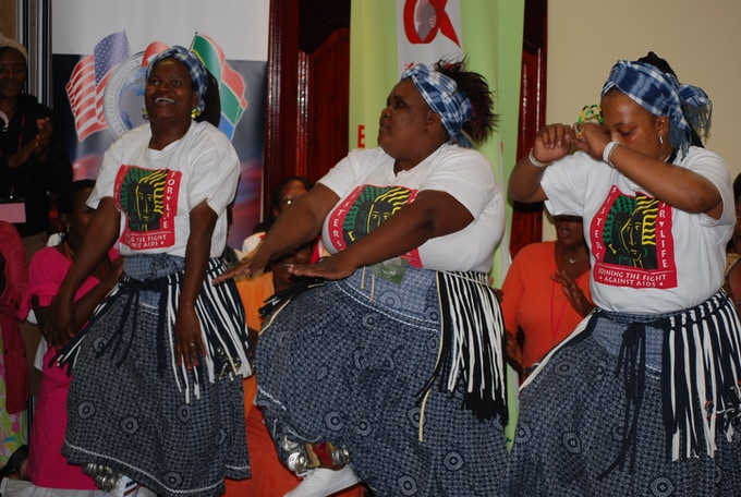Zanana (extreme right) traditional dancing at a PLHIV Conference