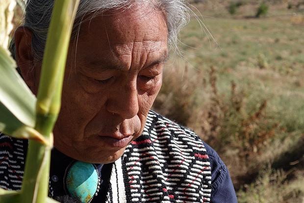 Lieutenant Louie Hena of the Tesuque Pueblo says a prayer for his communities native corn fields