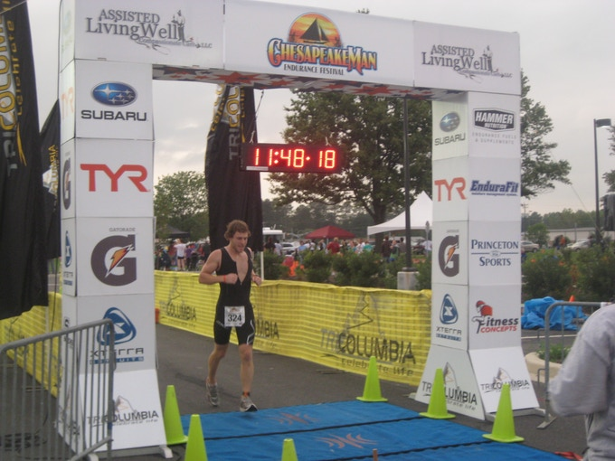 Crossing the finish line of the 2011 Chesapeake Man; this was my first Ironman distance Triathlon.