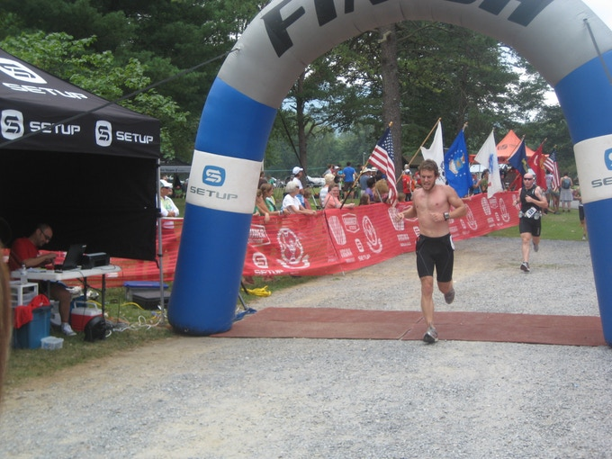 Crossing the finish line of the Luray International (Olympic Distance) Triathlon.