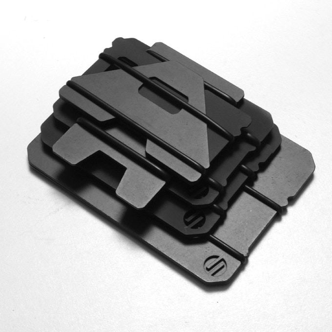 STACK OF HARD COAT BLACK ANODIZED WALLETS
