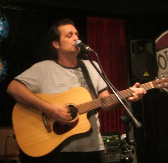 John Foster on acoustic lead guitar
