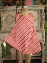 Just like our regular dress but in doll size. We have many colors and you will get one of our hand picked styles.