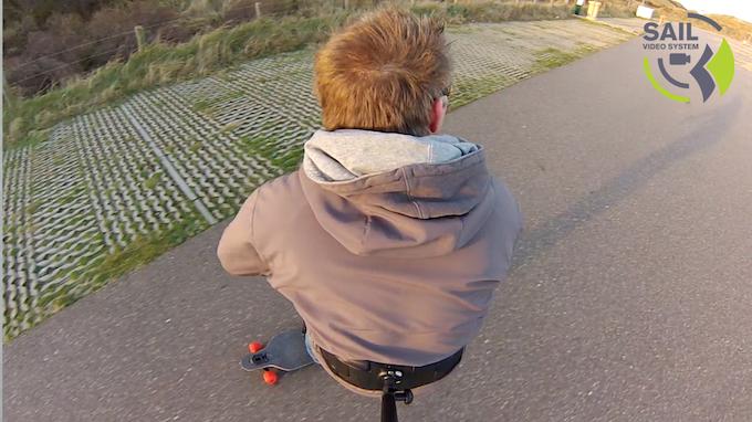 Testing the camera mount on a longboard.