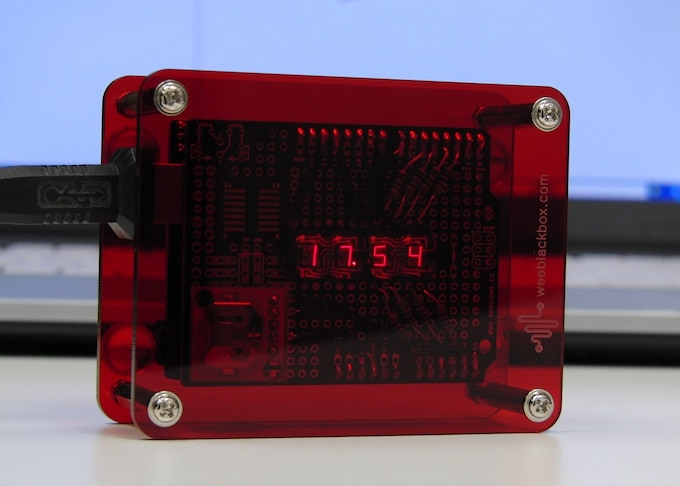 """Arduino clock displaying time using RTC module, vintage Litronix LEDs, housed in a """"RED UNO"""" Space Station enclosure."""