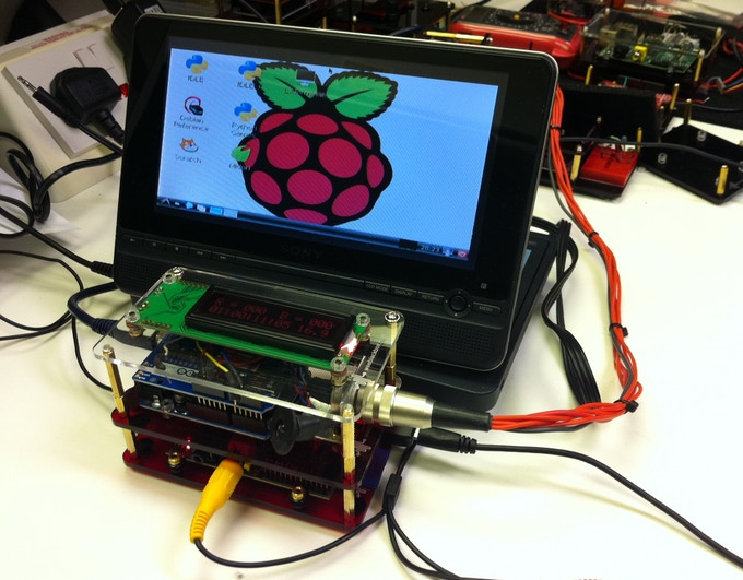 Raspberry Pi on the base, Arduino UNO with SD shield in the middle plus 16 x 2 LCD display on top. This system is controlling a set of LED lights and also logging data from temperature and light sensors.