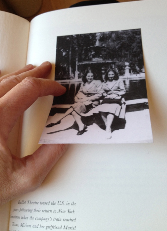 Photos are glued in by hand to the page with the English text.