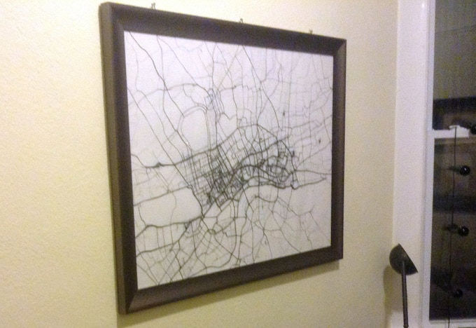 London print framed and hanging on a wall