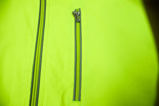 Reflective material along all zipper area.