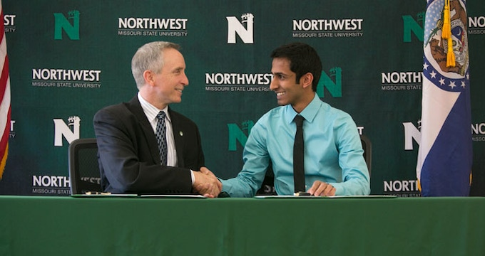 Northwest President Dr. John Jasinski and Northwest student Aakash Patel share a handshake after signing an agreement allowing Patel's start-up company, BlurPort LLC, to lease office space in Northwest's Center for Innovation and Entrepreneurship.