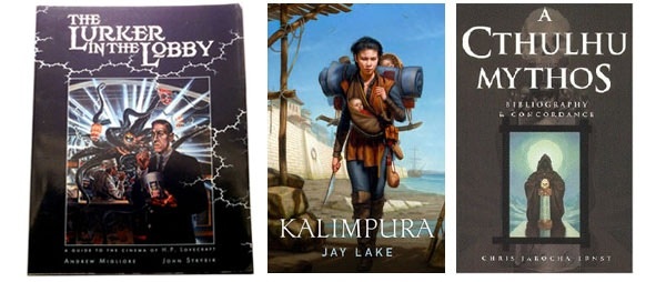 L to R: Signed 1st edition Lurker in The Lobby, signed advance copy of Jay Lake's latest novel, Kalimpura, and the Cthulhu Mythos Bibliography and Concordance.