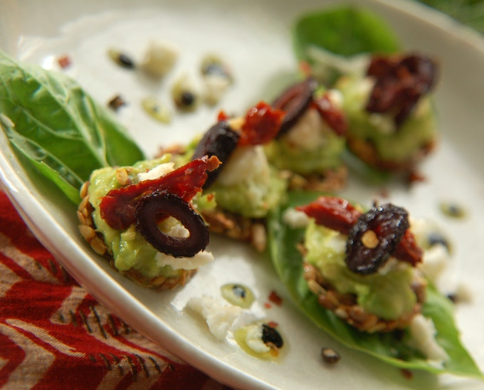 Raw bruschetta: raw goat milk feta, basil, sundried tomatoes and botija olives on an herbed flax & sunflower seed cracker